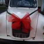 Le taxi anglais blanc de TaxiFun location voiture Montargis Office de Tourisme père Noël