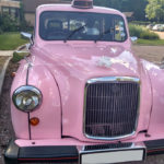 mariage taxi anglais rose location voiture de mariage avec chauffeur événement blackcab