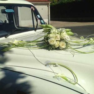 TaxiFun Taxi anglais blanc décoré par MOF meilleur ouvrier de France fleuriste location voiture de mariage avec chauffeur